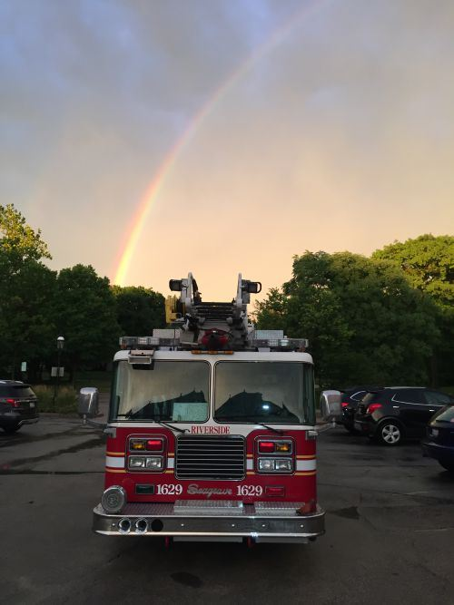 Fire Truck with Rainbow in Background