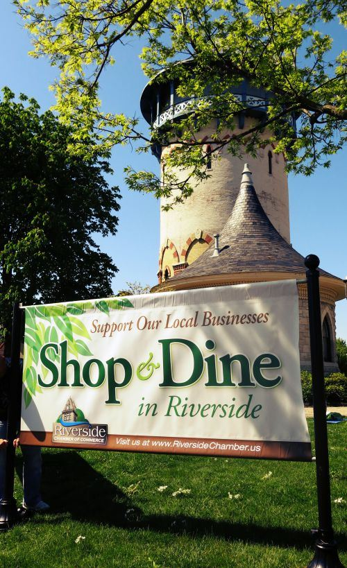 Shop and Dine Banner in Front of the Riverside Water Tower