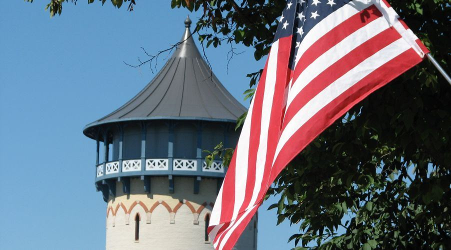 American Flag with the Water Tower in the Background