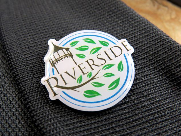Riverside Pin tilted on a grey shirt