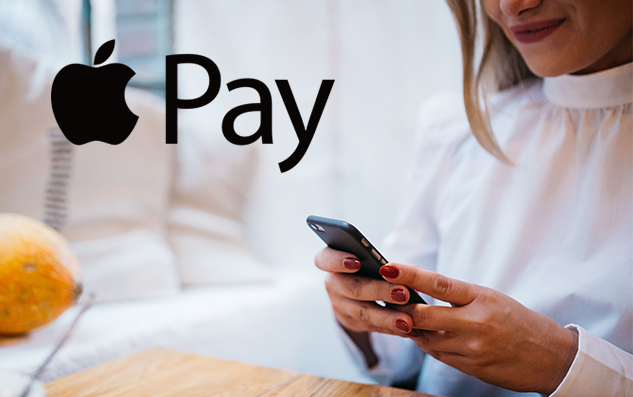 Apple Pay logo with a woman holding her phone