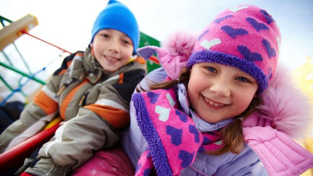 Happy kids wearing winter clothes