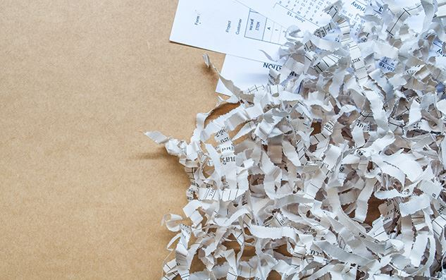 Paper-shredding-Closeup-texture-of-paper-scrap-of-document-on-brown-paper-background