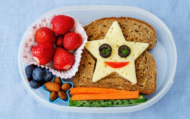 school-lunch-box-for-kid-with-food-in-the-form-of-funny-faces
