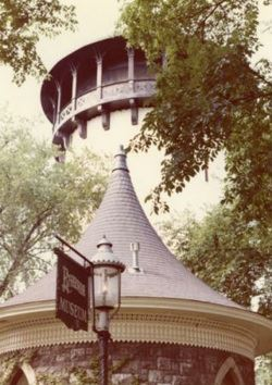 Close-up of the Historic Water Tower Museum with the Water Tower in the background