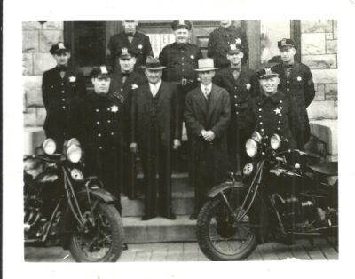 1936 Police officers in front of the station