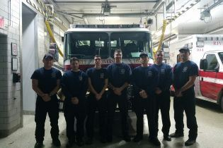 New Fire Department Candidates standing in front of the fire truck